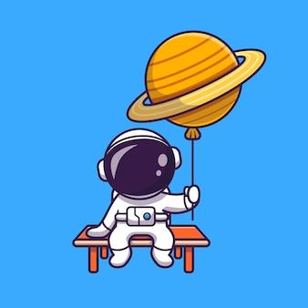 惑星の気球に座って保持しているかわいい宇宙飛行士