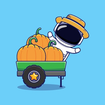 Cute astronaut wearing straw hat with pumpkins in the lorry