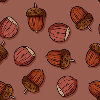 かわいい秋のヘーゼルナッツとドングリ漫画のシームレスなパターン。