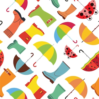 Cute autumn pattern with rubber boots and umbrellas. fall season seamless background