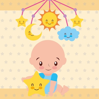 Cute baby boy sitting with star and crib mobile