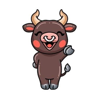 Cute baby bull cartoon waving hand