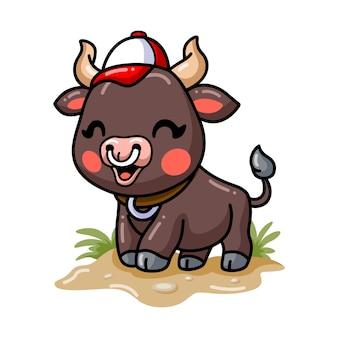 Cute baby bull cartoon wearing hat
