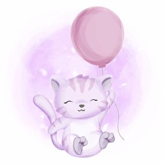 バルーンを保持しているかわいい赤ちゃん猫