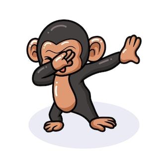 かわいい赤ちゃんチンパンジーの漫画を軽くたたく