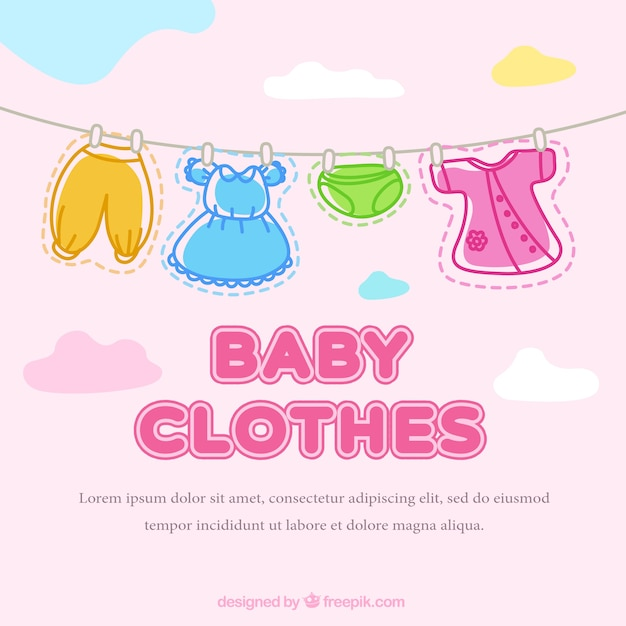 Cute baby clothes hanging on a rope background