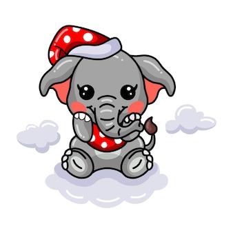 빨간 모자를 쓰고 귀여운 아기 코끼리 만화