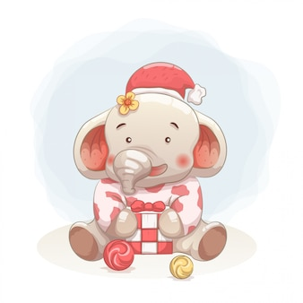Cute baby elephant happy to get gift in christmas.