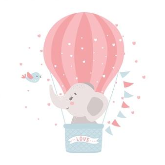 Cute baby elephant in a hot air balloon.