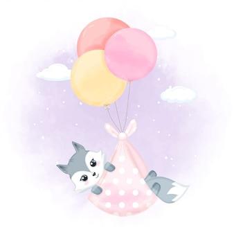 風船でかわいい赤ちゃんキツネ