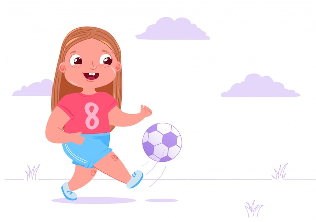 Cute baby girl playing football outside on grass with a soccer ball.