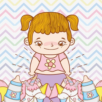 Cute baby girl with funny toys