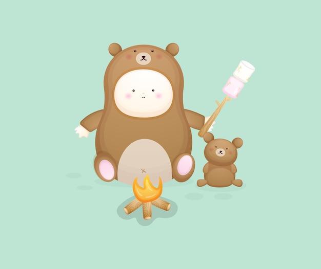マシュマロを保持しているクマの衣装でかわいい赤ちゃん。漫画イラストプレミアムベクトル