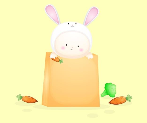 Милый ребенок в костюме кролика внутри бумажного пакета. карикатура premium векторы
