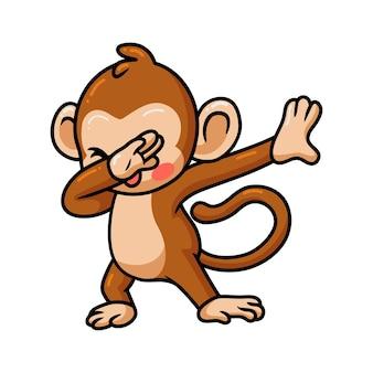 かわいい赤ちゃん猿の漫画を軽くたたく