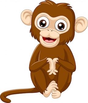 Милый ребенок сидит обезьяна