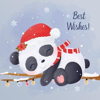 冬の夜に眠っているかわいい赤ちゃんパンダ
