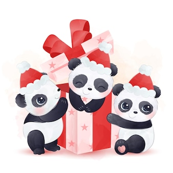 Cute baby pandas playing together with a gift box