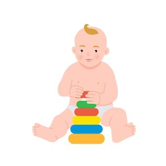 カラフルなレインボーグッズピラミッドで遊ぶかわいい赤ちゃん。小さな子供向けのおもちゃ。発達中のおもちゃを持つ子供。初期の開発。 。