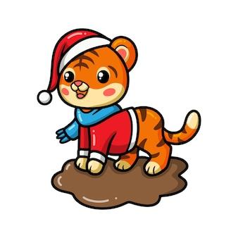 Мультфильм милый тигренок в шляпе санта-клауса