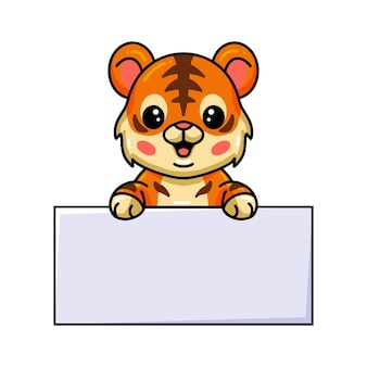 Cute baby tiger cartoon with blank sign