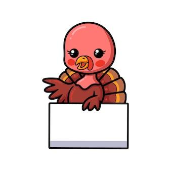 Cute baby turkey cartoon with blank sign