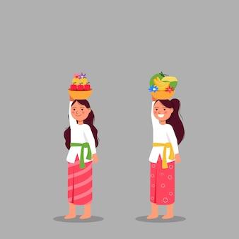 バリ式のかわいい女の子が儀式に供物をもたらす