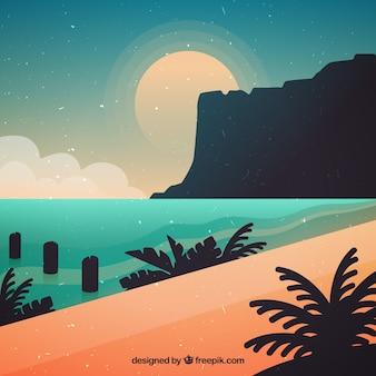 夕日の背景にかわいいビーチ