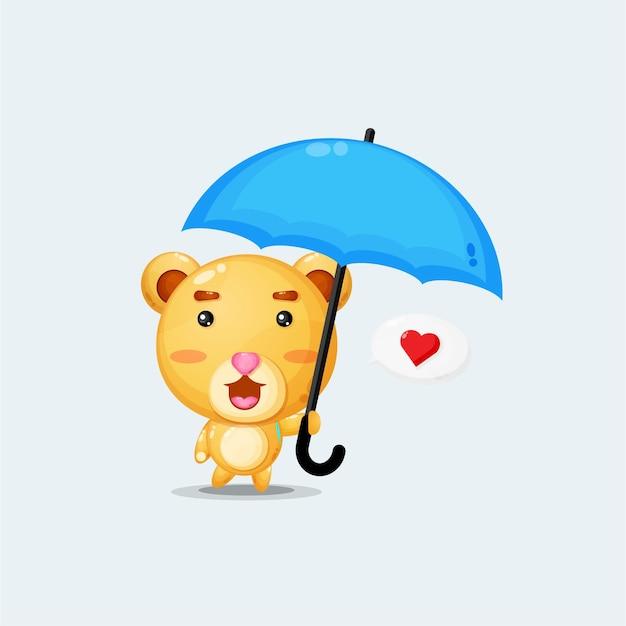 傘をさしてかわいいクマ