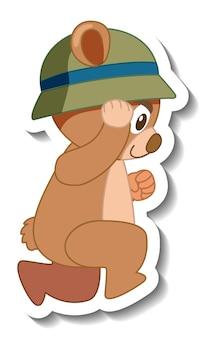 帽子のステッカーの側面図を身に着けているかわいいクマの漫画