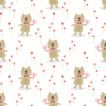 Cute bear hold a heart seamless pattern.