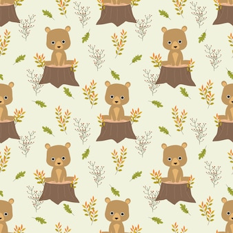 Cute bear is sitting on stump in autumn leaves background.