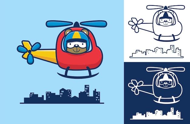 かわいいクマが建物の上を飛んでいるヘリコプターを操縦しました。