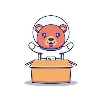 段ボールに宇宙飛行士のスーツを着てかわいいクマ
