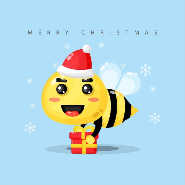 Cute bee mascot brings a gift box on christmas day