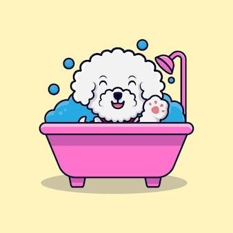 Милая собака бишон фризе машет лапами в ванной