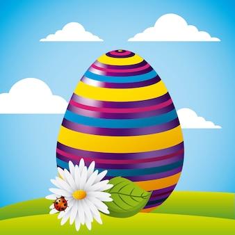 かわいい大きなストライプの卵、花とひな鳥の畑