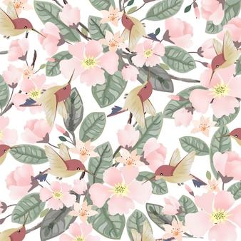 かわいい鳥と緑の葉のシームレスなパターンとピンクの花
