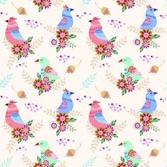 ファブリックテキスタイル壁紙の花のシームレスなパターンを持つかわいい鳥。