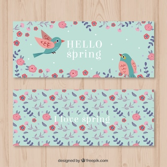 Uccelli svegli fra i fiori banner