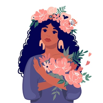 A cute black girl holding a bouquet of flowers.