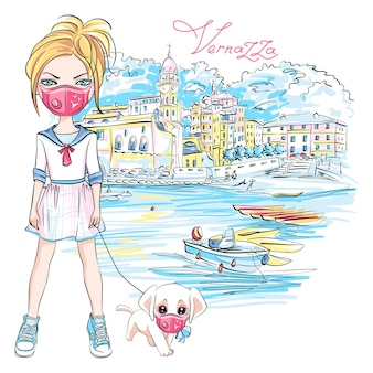 Cute blond girl walking a dog during coronavirus quarantine in vernazza, liguria, italy. girl and dog in protective masks.