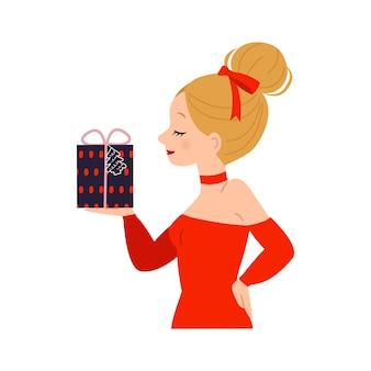 Cute blonde woman with hair bun holding a christmas gift box