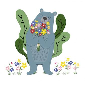 Cute blue bear holding flowers in garden