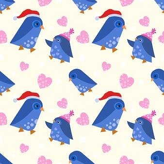 귀여운 파란색 펭귄은 하트 모양 패턴이 있는 크리스마스 모자를 착용합니다.