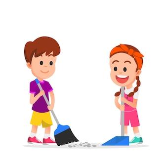 귀여운 소년과 소녀는 먼지에서 바닥을 청소