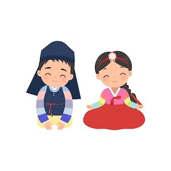 한국 전통 의상을 입은 귀여운 소년과 소녀