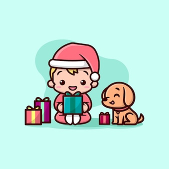 귀여운 소년과 그의 개가 크리스마스 선물을 열고 싶어합니다.
