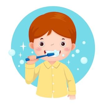 Cute boy brushing his teeth in pijamas