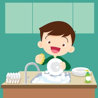 Cute boy doing dishes teenage washing dishes